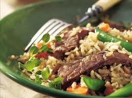 Beef, brown rice, and veggies.